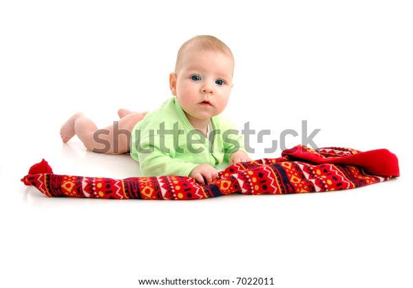 a little baby in a large red hut portrait isolated on white