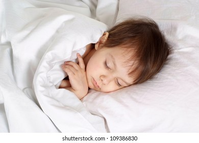 Little baby lying on bed at home