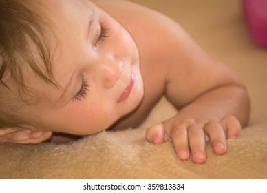 Little baby lying on a cozy blanket