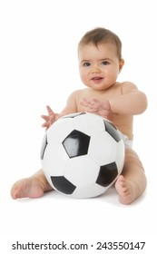 Little baby is playing with a football.