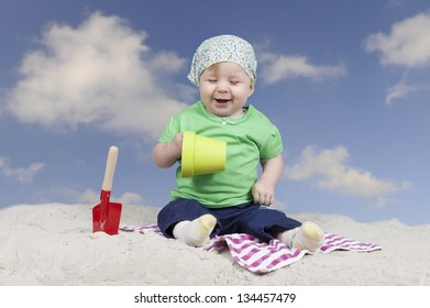 little baby playing outdoors on the beach