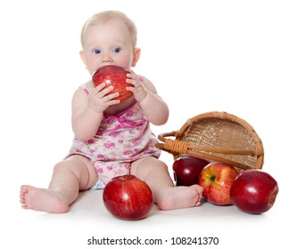 The little baby with red apples isolated