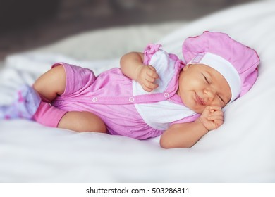 little baby sleeping. The concept of newborn and family.