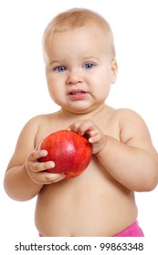 Little baby standing with apple, isolated on white