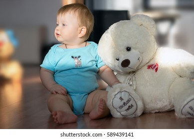 Little baby with teddy bear (text on russian: I love you)