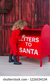 little baby throwing letters to Santa christmas time asking for presents