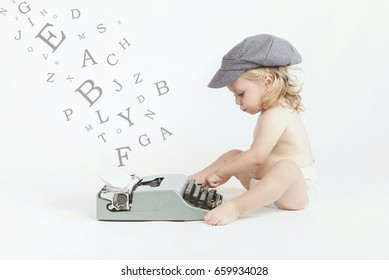 Little baby typing with a typewriter