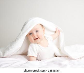 Little baby under white  towel