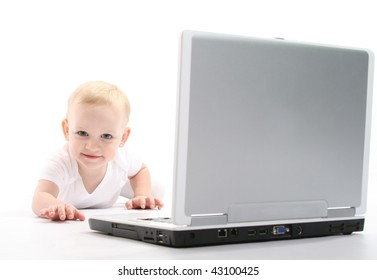 Little baby using laptop over white