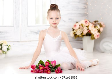 little ballerina with a bouquet of pink tulips, March 8