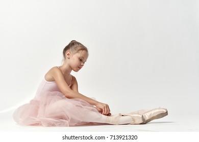 little ballerina doing stretching.