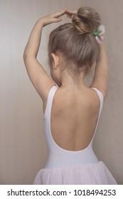 the little ballerina held up her hands