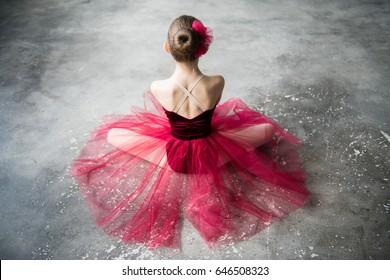 little ballerina red tutu sitting on floor back