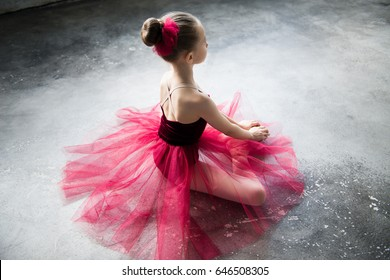 little ballerina sitting on floor