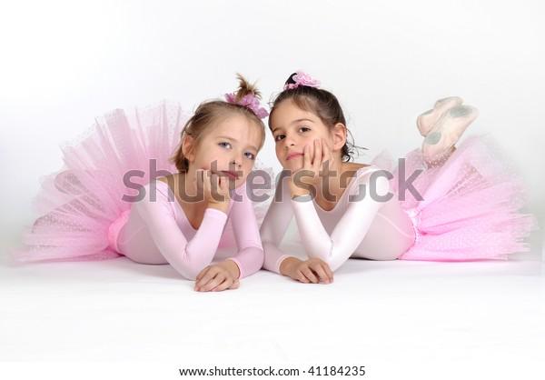 Little ballet dancers over white background
