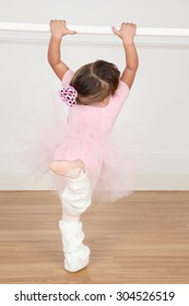 Little ballet girl dancing in the dance studio