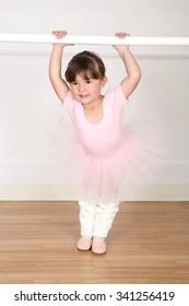 Little ballet girl dancing in the dance studio