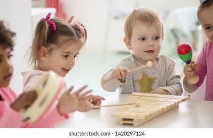 Little band. Children in preschool.