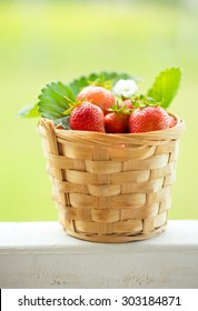 Little basket with strawberries .