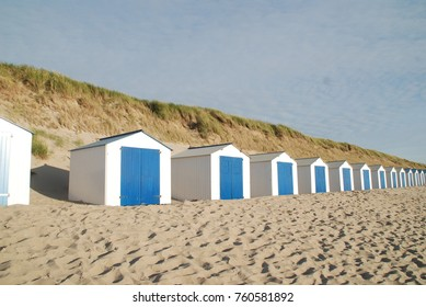 Little beach cabins at a North Sea on waddeneiland Texel Holland
