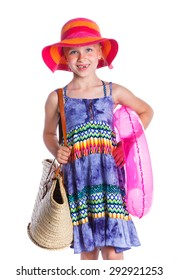 Little beach girl is dressed in summer dress, sunglasses and hat. Isolated On White Background.