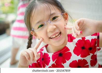 Little beautiful asian girl with glasses