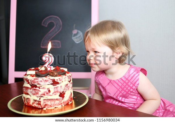 Fantastic Little Beautiful Baby Girl Blowing Out Stock Photo Edit Now Funny Birthday Cards Online Hetedamsfinfo