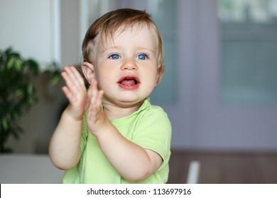 little beautiful boy claps
