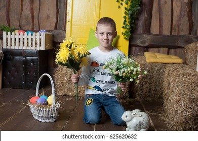Little beautiful boy holding a bouquet of flowers