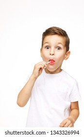 little beautiful boy with a lollipop on a white background