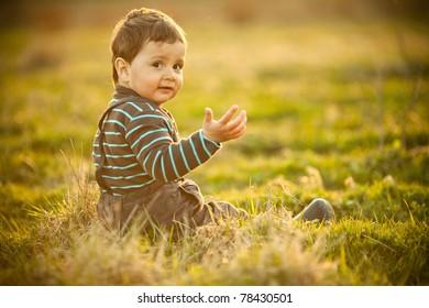 little beautiful boy on field
