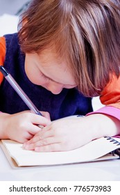 little beautiful child girl learns to write (preschool, development, training, education concept)