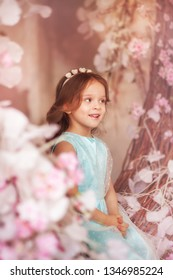 Little beautiful girl in fairy spring garden