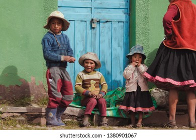 Little beautiful girl with her mom and her brothers. January 2018. Cusco, Peru.