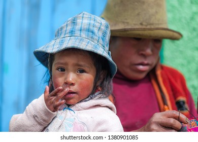 Little beautiful girl with her mom. January 2018. Cusco, Peru.
