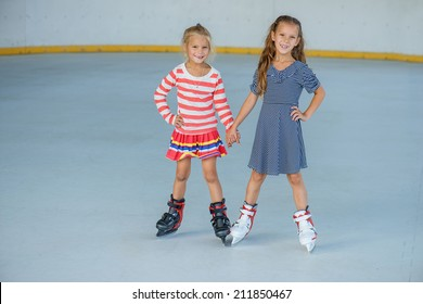 Little beautiful girl ice skating at stadium.