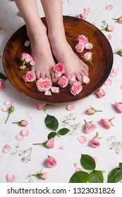Little beautiful legs take bath with rose petals