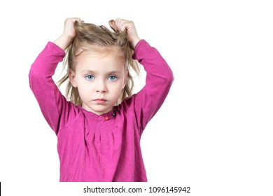 Little beautiful sad girl pulls her hair isolated on white background