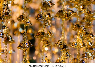 Little Bells for good fortune, in front of the Mondop of the Buddha's Footprint. A Temple at the Wat Arun Temple complex in Bangkok, Thailand.