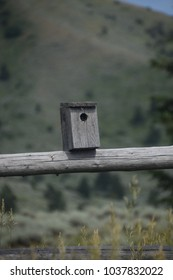 A little birdhouse on a fence in Wyoming
