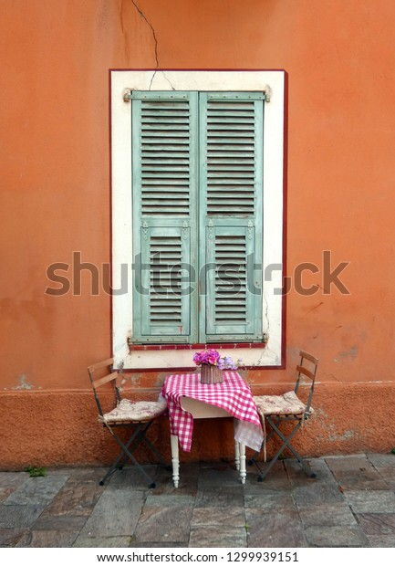 Little bistro table in front of a house in southern France