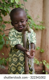 Little black boy asking begging for clean water. Its scarcity affects every continent. Around 1 billion people, live in areas of physical scarcity, and many more people approach this situation.