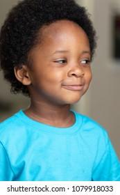 Little black boy making an amused face