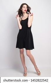 little black dress  beautiful fashion model posing isolated in studio