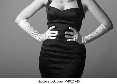 a little black dress with white opera gloves