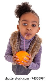 Little black girl drinking orange juice with a straw