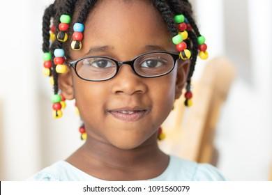 Little black girl with glasses