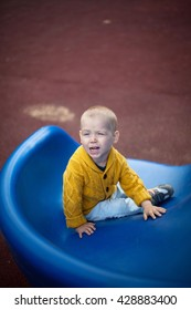 Little blond boy on a play ground, selective focus
