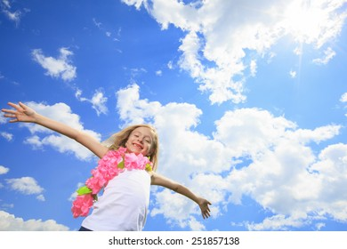 A Little Blond Girl Fly High with sky on the background