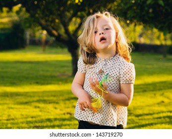 Little blond girl with funny expression
